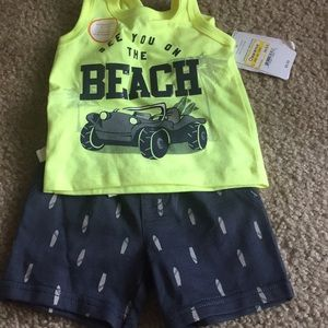 Brand new 2 pair of outfits, 3 shorts and 1 onsie.